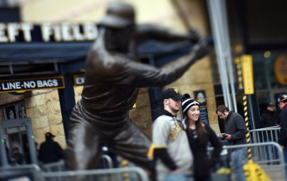 Ben Phillips and Jess Cabin get a picture in front of the Willie Stargell statue. (Steve Mellon/Post-Gazette)