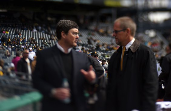 Owner Robert Nutting chats before the first pitch of the season. (Steve Mellon/Post-Gazette)