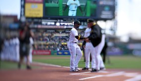 Pirate Andrew McCutchen is greeted by manager Clint Hurdle. (Steve Mellon/Post-Gazette)