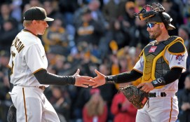 Matt Freed/Post-Gazette Pirates' Francisco Cervelli congratulates closer Mark Melancon after defeating the Cardinals Sunday at PNC Park.