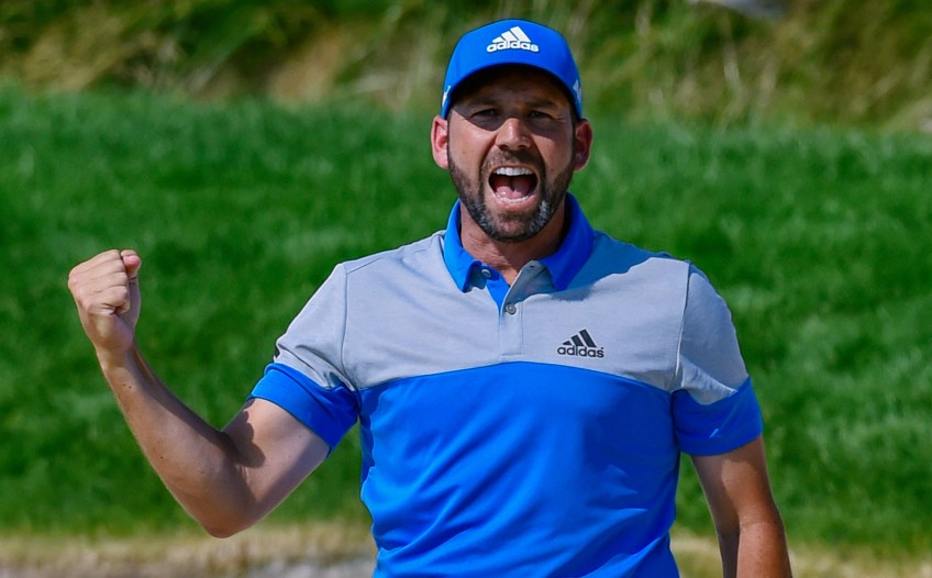 Sergio Garcia celebrates after holing his shot out of a bunker for a birdie on the eighth hole on Sunday. (Matt Freed/Post-Gazette)