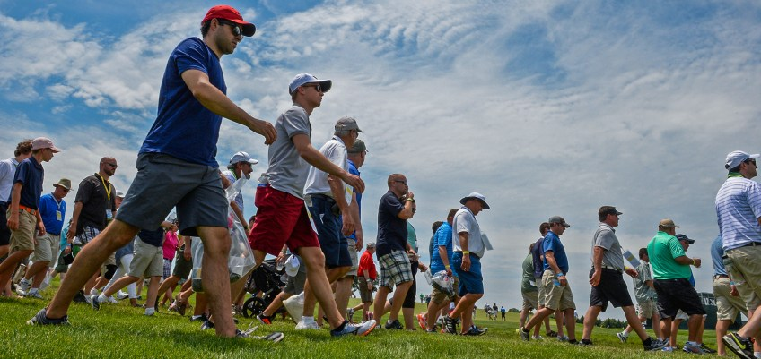 Spectators cross the 12th fairway during practice rounds for the U.S. Open Wednesday. (Matt Freed/Post-Gazette)