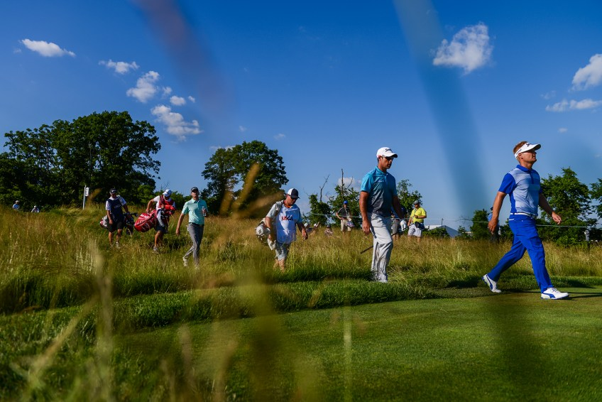 Golfers from Group 6 walk down the fairway after teeing off at hole 4 during the second round on Friday. (Rebecca Droke/Post-Gazette)