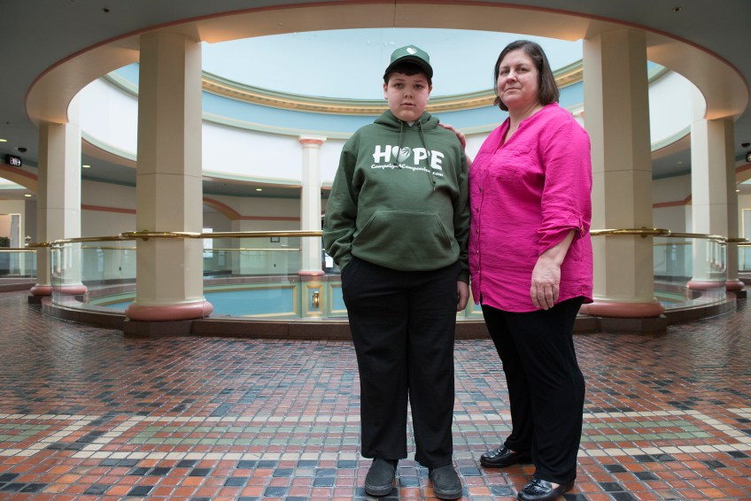 """Erin McCann of Collegeville, Pa., stands with her son Ryan, 12,  at the state Capitol building on Tuesday, March 15, 2016. Ms. McCann has been to Harrsiburg about 20 times and Ryan, who has intractable epilepsy, has come 6-7 times to advocate for the legalization of medical marijuana. At 21-months Ryan had surgery, removing all of his right brain in an effort to stop the seizures. He did """"pretty well,"""" unitl he was nine years old and he began having tonic clonic seizures where he would drop to the ground, says his mother. Although the McCanns had started advocating for medical marijuana for Ryan at this point, they decided they couldn't wait for medical marijuana to become legalized before they stopped the seizures. He underwent brain surgery again. """"It's frustrating having to go through brain surgery during this because there was a possibly this [medical marijuana] could have made a difference without having to remove any more of his brain. It would have been nice to have this chance before going to something radical as that."""" She also adds, """"A lot of people don't realize the need today, but at some point in time one of their family members may benefit from this and hopefully they will open their minds to it."""""""