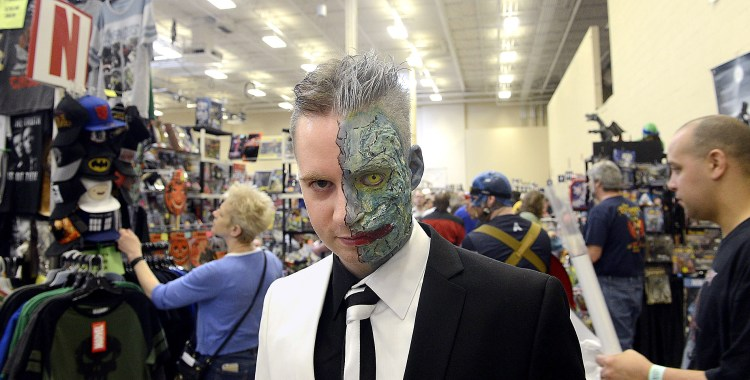 "Larry Roberts/Post-Gazette    20160417   steel city con A2 layout Jesse (cq) Olszewski (cq) from Erie came to Steel City Con with his friends, all of whom dressed as characters from ""Batman,"" April 17, 2016. Jesse is dressed as ""Two Face."""