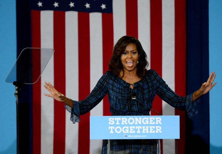 First Lady Michelle Obama campaigns on behalf of Democratic presidential candidate Hillary Clinton at the Fitzgerald Field House on the University of Pittsburgh Campus in Oakland.
