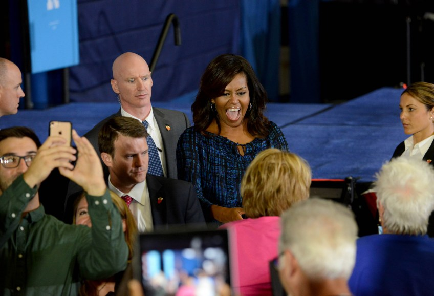 First Lady Michelle Obama greets people.
