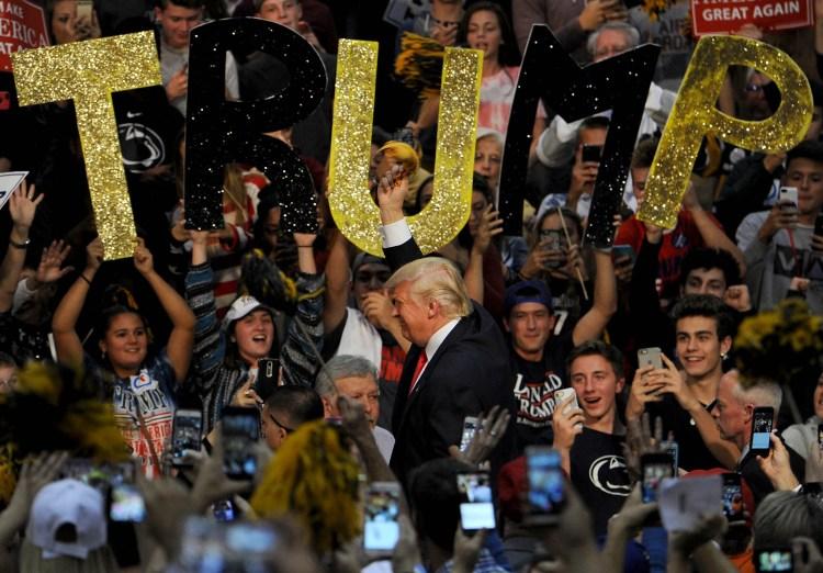 Donald Trump waves the terrible towel upon entering a campaign event at Ambridge High School. Michael Henninger/Post-Gazette