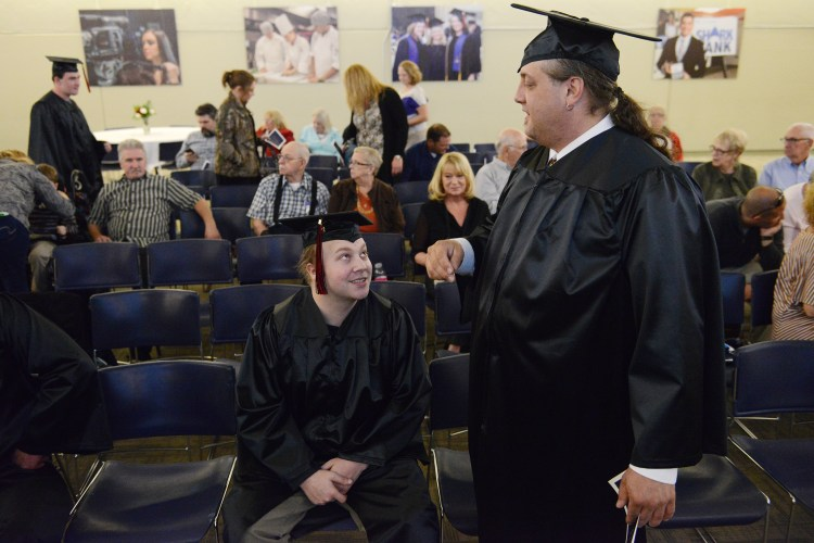 "Rebecca Droke/Post-Gazette--Wednesday, October 12, 2016--STANDALONE LOCAL--Zach Harshman, left, of Uniontown and David Vincze of New Alexandria, chat before the graduation ceremony for students from ITT Technical Institute at Pittsburgh Tecnical College in Oakdale Wednesday, October 12, 2016. In September ITT abruptedly closed amid a federal inquiry. PTC stepped forward to host a graduation ceremony-- which eight students attended, providing caps and gowns for graduates. Mr. Harshman said it was ""very awesome,"" that PTC hosted the graduation ceremony. His mother and other family members want to see him gradaute and take pictures, which they otherwise wouldn't have been able to do after the closing of ITT."