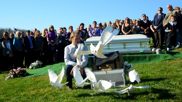 Nick Brozovich, of Memory Makes, releases doves after the funeral service of Dalia Sabae at Oak Spring Cemetery in Canonsburg on Friday, November 18, 2016.   Hundreds of people gather at the Cemetery to pay respects to Dalia Sabae Dalia Sabae, who was three months pregnant, was killed by her husband, Michael Cwiklinski,  the same night he ambushed Canonsburg police.