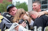 Steve Hribik, left, of Bloomsburg, gets emotional as he hugs his daughter Jennifer Fusco, of Pittsburgh, after finally getting to watch a Penguins game with all of his children at PPG Paints Arena on Sunday, May 21, 2017. Hribik has been following the Penguins since 1967 and has been to a game with his son Mike Hribik, far right, of Bloomsburg, but never with all of his kids. The Penguins defeated the Senators 7-0 in the NHL Eastern Conference Finals Game 5 of the Stanley Cup Playoffs outside. The Penguins defeated the Senators 7-0. (Antonella Crescimbeni/Post-Gazette)