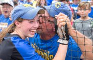 John Lampe, of West Greene, kisses his daughters cheek, Madison Lampe (4), after the team came back to win the state championship at Beard Field on Friday, June 16, 2017. West Greene was down 7-0 in the 2nd inning and defeated Williams Valley 9-8. (Antonella Crescimbeni/Post-Gazette)