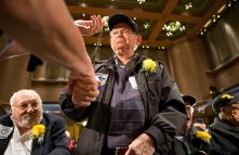 World War II veteran Richard Gardner, served in the U.S. Army from 1944-1946, shakes hands and receives a personalized military dog tag during the World War II Veteran Recognition ceremony hosted by Soldiers and Sailors in partnership with the Veterans Breakfast Club on Sunday, Nov. 5, 2017 at the Soldiers & Sailors Memorial Hall & Museum in Oakland. (Antonella Crescimbeni/Post-Gazette).