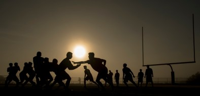 The sun rises over West Allegheny's defending Class 5A WPIAL champion defense as they work out at 7 a.m. during a preseason practice on Wednesday, July 26, 2017 at West Allegheny High School. (Steph Chambers/Post-Gazette)