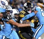 Pittsburgh Steelers Le'Veon Bell runs the ball through a collection of Titans on Thursday, November 16, 2017, at Heinz Field in Pittsburgh. (Peter Diana/Post-Gazette)