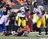 Pittsburgh Steelers JuJu Smith-Schuster stands over Bengals Vontaze Burfict after a big hit Monday, December 4, 2017, at Paul Brown Stadium in Cincinnati. (Peter Diana/Post-Gazette)