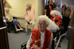 """Brides from left Jean Rosfeld, 87, Barbara Murawski, and Patricia Phoebe, foreground, 89, wait to process into the marriage vow renewal ceremony held in honor of Valentine's Day on Tuesday, Feb. 14, 2017, at Asbury Heights senior living community in Mt. Lebanon. Ten couples, including one couple married for 77 years, renewed their vows Tuesday. """"Marriage doesn't work unless God is in the mix. You can't fail with him,"""" says Barbara Murawski. She married Carl Murawski in 1954. """"He's still the greatest,"""" Barbara says after 62 years of marriage. (Rebecca Droke/Post-Gazette)"""