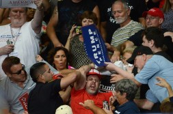 """A protester is pulled out of the crowd as President Donald Trump speaks to crowd during the """"Make America Great Again"""" rally Tuesday, July 25, 2017, at the Covelli Centre in Youngstown, Ohio. (Rebecca Droke/Post-Gazette)"""