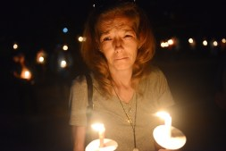 """Kelly Gibson of Lawrenceville reacts as she listens to a speaker during the Not One More vigil and recovery celebration Friday, September 22, 2017 at Arsenal Park in Lawrenceville. """"It's hard. I was just crying and sad,"""" said Gibson, who lost three cousins to heroin overdoses. (Rebecca Droke/Post-Gazette)"""
