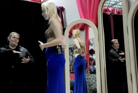 Bridget Grejda of Dormont gives advice to her daughter Kayle Wasky, 19, a senior at Keystone Oaks High School while choosing her prom dress at the National Council of Jewish Women Thriftique shop in Lawrenceville on Tuesday, March 21, 2017. The Project Prom Giveaway assures local students to have the opportunity to go to their prom affordably. (Lake Fong/Post-Gazette)
