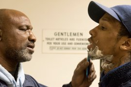 Johnny Spell Sr. shaves his son's face in the locker room before his boxing match at the Western Pennsylvania Golden Gloves Championships on April 1, 2017 at the 3 Lakes Golf Course in Penn Hills. Fighters are not allowed to have facial hair because it can lead to cuts near the eyes. Johnny Spell III lost by decision to Danny Bodish of Steel City Boxing, a result that few expected from the matchup. (Haley Nelson/Post-Gazette)