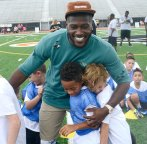 Pittsburgh Steelers wide receiver Antonio Brown greets the youths from grades 1-8 who came to Bethel Park High school to learn the basics of football in a two-day camp on Sunday, July 23, 2017. (Larry Roberts/Post-Gazette)
