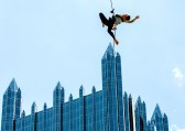 Susan Harkey, an aerial dancer from Blue Lapis Light, rehearses on the side of Fifth Ave Place on Wednesday, May 31, 2017 to prepare for shows during the Arts Festival. (Andrew Rush/Post-Gazette)