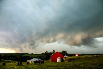 Storm clouds roll over a farm in Muddy Creek Twp. on July 10, 2017. (Andrew Rush/Post-Gazette)