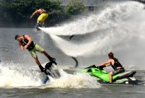 """Gavin Melan, of Belle Vernon, and Gabriel Taylor, of Elizabeth, show their abilities of """"Fly Boarding"""" as part of the Jet Ski Stunt Shows press event for the upcoming EQT Pittsburgh Three Rivers Regatta on Wednesday July 19, 2017. They both have be fly boarding for two years. (Darrell Sapp/Post-Gazette)"""