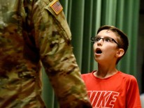 Damon Chiodo, 11, a 6th grader at Carnegie Elementary, drops his jaw as he turns and sees his brother for the first time in two years on Friday, September 29, 2017 in Carnegie. Damon had just completed his essay ÒMy hero is my brother, Devin Tomei.Ó S.P.C. Devin Tomei is Specialist Military Occupational Specialty (M.O.S) and works on CH-47 helicopters in Germany. (Darrell Sapp/Post-Gazette)