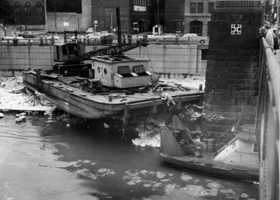 A barge resting under the 7th Street Bridge (Sun-Telegraph photo)