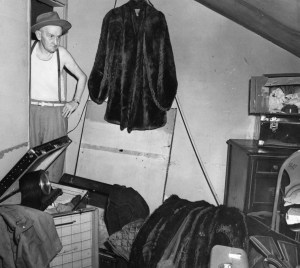 Detective Martin McIntyre found a hidden stash by tapping walls and listening for hollow sounds. (Pittsburgh Press photo)