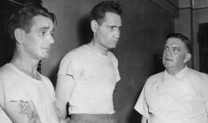 Wright, center, after his arrest in 1952. (Pittsburgh Press photo)