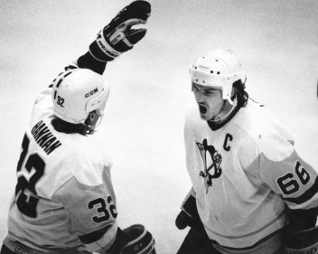 Lemieux is greeted by Dave Hannan after scoring in the first period against the Flyers, Apr. 26, 1989 (The Pittsburgh Press photo)