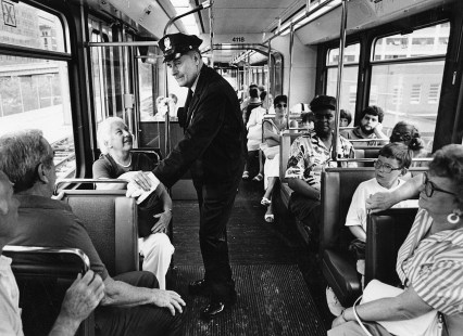 Retired Pittsburgh traffic cop Vic Cianca aboard LRT PAT car greeting riders, June 30, 1987. (Photo by John Beale/Post-Gazette)