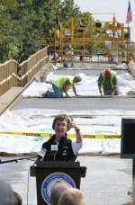 Allegheny Trail Alliance President Linda McKenna Boxx addresses the crowd at the Riverton Railroad Bridge, 2008 (Darrell Sapp/Post-Gazette)