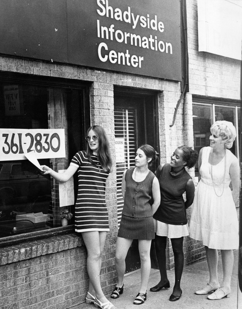 Information center staff shows number to call when you have problems, 1972