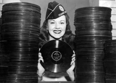 Carol Mansfield of Wilkinsburg with donated records. (Sun-Telegraph photo)