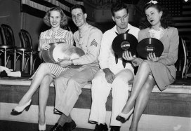 Couples with donated records for the War Records Dance at the William Penn Hotel. (Sun-Telegraph photo)