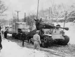 A Sherman tank pulled stalled trucks from the street. (Post-Gazette photo)