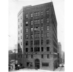 The building housed two newspapers when it was completed in 1915. (Photo credit: Unknown)