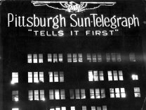 Lighted sign with a Hearst eagle atop the building in 1938. (Sun-Telegraph photo)