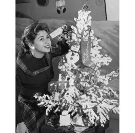 Carey decorating a Christmas tree in 1959. (Pittsburgh Press photo)