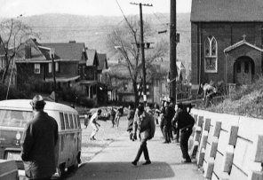 Angry groups of students toss rocks and bottles at each other. (Albert Herrmann Jr./The Pittsburgh Press)