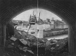 May 25, 1958: This is a photo composite found in the Post-Gazette archive. A photo of the rocks and edge of the tunnel was combined with an image of the city and bridge construction.
