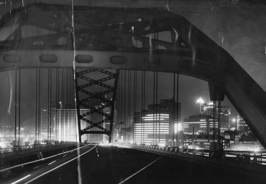 Jan. 17, 1967: While the view of the city coming out of the tunnel has changed with new buildings, the nighttime glow remains. (Post-Gazette photo)