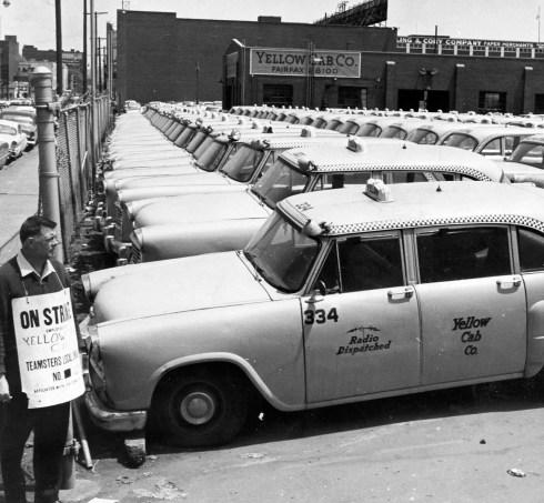 Picket George Shanafelt surveys strike idled Yellow Cab (May 18, 1961).