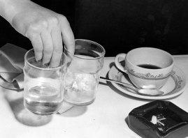 Improper handling of glasses by a waitress. (Stewart Love/The Pittsburgh Press)