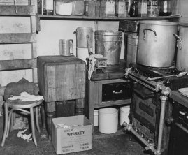 This cooking space harbored countless cockroaches. (Stewart Love/The Pittsburgh Press)