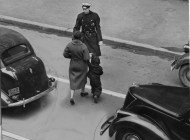 March 13, 1959: A woman and her child, jaywalking through traffic on Stanwix Street near Liberty Avenue, were greeted with a safety lecture. (Pittsburgh Press photo)